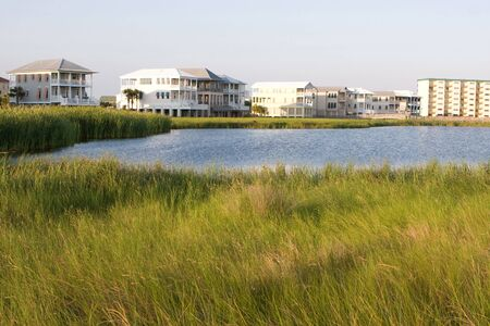 encroaching: Luxury high-end vacation homes encroach on wetlands in Destin, Florida