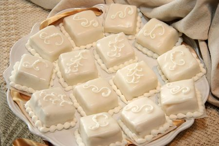 petit: Miniature pieces of wedding cake are served as petit fours at the reception.