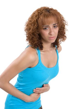 premenstrual syndrome: A young woman bends over, reacting to her stomachache. Stock Photo