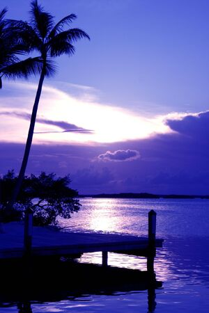 The sun sets behind a cloud bank in this tropical sunset on a Florida Keys island. Stock Photo - 5514524