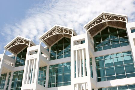 The modern architectural design of a steel and glass building facade.