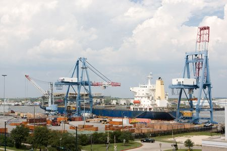 A freighter is being loaded by cranes at the port of Mobile, Alabama located on the Mobile River. photo