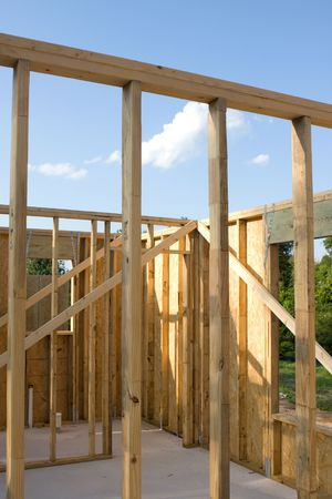 Stud wall construction for a new home built of wood with a concrete slab floor. Stock Photo - 5586798