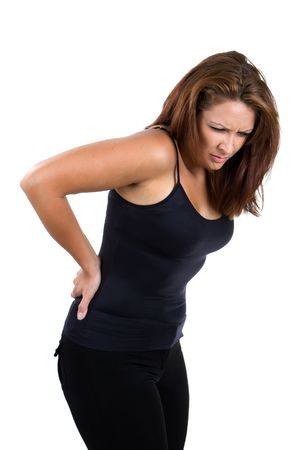woman back pain: Woman bends over and flinches in pain in her back.
