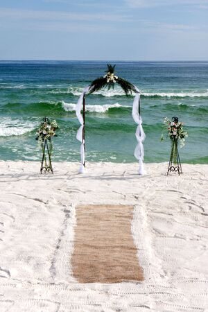 Archway with flowers and carpet are erected for a beach wedding. Stock Photo - 5723854