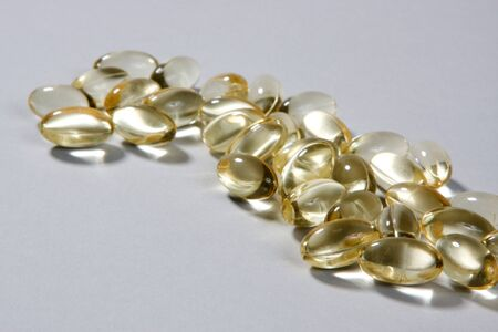 Vitamin E supplement capsules on a white background Stock Photo