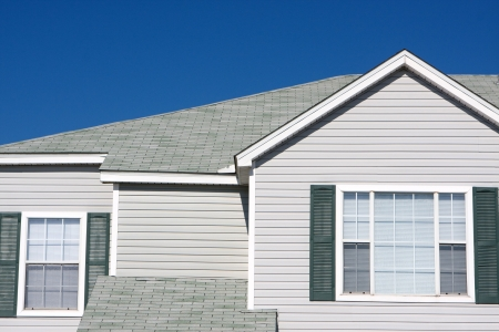 second floor: The second floor of an apartment building against a blue sky. Stock Photo