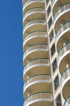 rentals: Terraces of modern condominium, used as vacation rentals, rise against a blue sky. Stock Photo