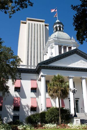 The old Florida State Capital building in Tallahassee sits in front of the new modern capital building which can be seen rising in the background. The old capital building is now a museum.