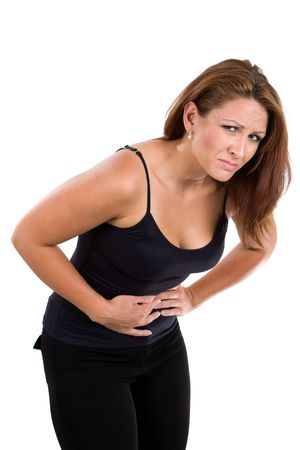 Woman with indigestion bends over in obvious agony. photo