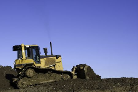 Bulldozer in operation moving dirt and clearing the land. Room for copy above. Stock Photo - 6301318