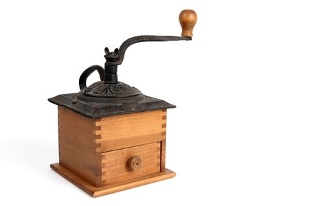 Antique coffee grinder made of wood and metal with a handle.