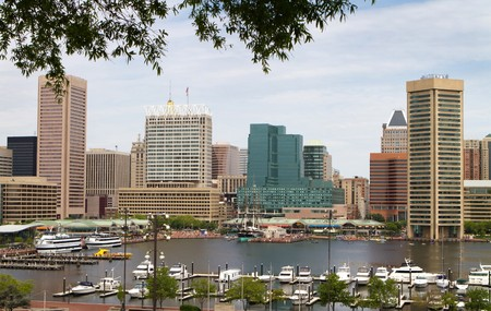 maryland: Baltimore city inner harbor showing the city skyline, ship, and pleasure craft docks and boardwalk. Stock Photo
