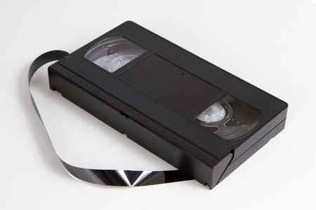 obsolescence: Obsolescent video tape cassette with tape.