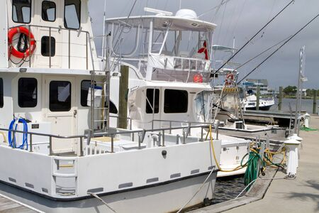 rentals: Charter fishing boats sit idle at the dock.