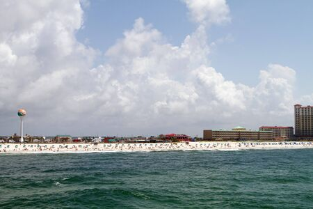 pensacola beach: Pensacola Beach skyline with shore filled with tourists and vacationers.