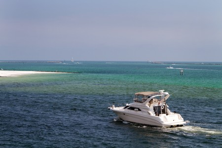 destin: Cabin cruiser motors through the waters of Destin Pass, Florida.
