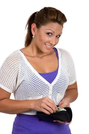 Woman about to make a purchase, reaches into her purse to take out her money.  photo