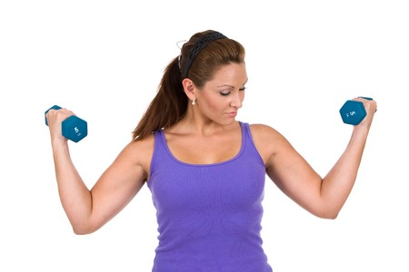 Woman uses dumbbells to do resistance weight training exercises. photo