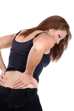 lumbar: Woman bends over in pain rubbing her lower back as a result of a spinal injury accident.