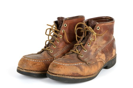 dated: Pair of old steel toed shoes in very used condition. Stock Photo