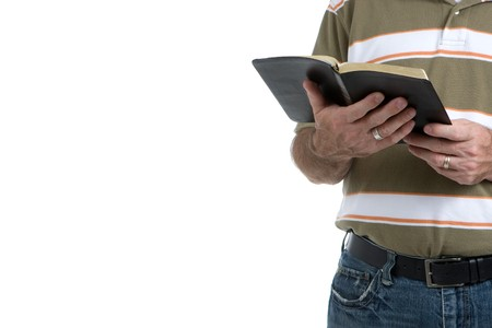 Street preacher holds his open bible wearing jeans and a sports shirt. Isolated with room for copy on left. photo