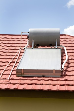Solar water heater sits on the roof of a home in Manchester, Jamaica.
