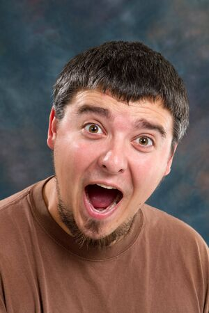 unawares: Man shows his surprise and gleefulness with the expression on his face. Stock Photo