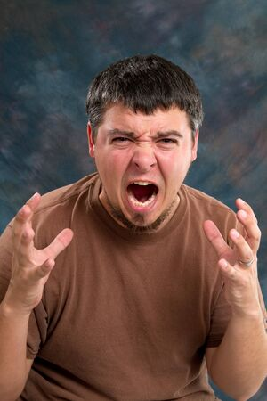uncontrolled: Enraged man who is close to tears, screams and gestures with his hands.