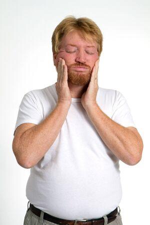 Hombre afligido tiene su rostro en angustia mental. Foto de archivo - 8169165
