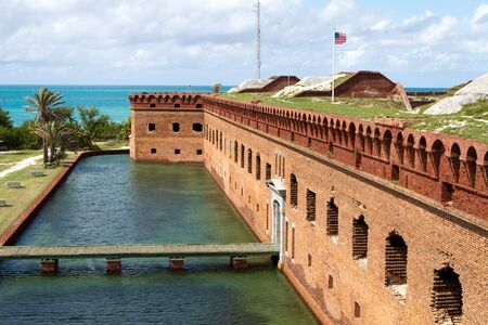 dry tortugas: Wooden footpath crosses the moat and leads to the entrance of Fort Jefferson National Park in the Dry Tortugas. Stock Photo