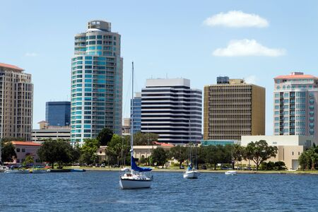 Boat are moored in the yacht basin with the city skyline of downtown St. Petersburg, Florida in the background.