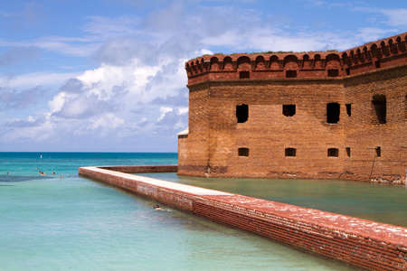 fort jefferson: Tourists snorkel the clear calm waters surrounding Fort Jefferson National Park in the Dry Tortugas, which is part of the Florida Keys. Stock Photo