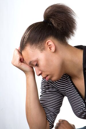 African American woman rests her forehead on her palm in a state of depression. Stock Photo - 9019295