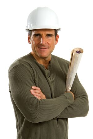 Boss of a construction company stands with crossed arms and holding blueprints against a white background. Imagens