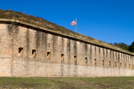 ramparts: U.S. Flag on top of the ramparts of Fort Barrancas in Pensacola Naval Air Station, Florida.