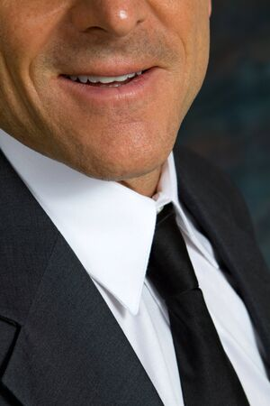 Close up of businessman's chin and lower face while wearing a coat and tie and white shirt. Stock Photo - 11741408