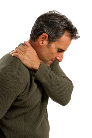 aching muscles: Middle aged man rubs his shoulder to relieve the painful muscles.