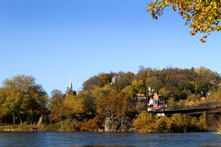 appalachian trail: Town of Harpers Ferry National Historical Park in West Virginia as seen from Maryland looking across the Potomac River in autumn.