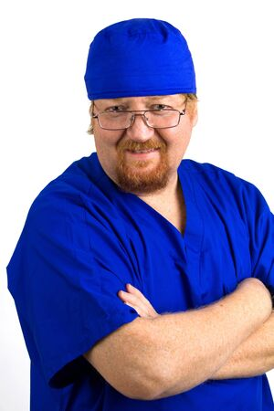 Smiling male nurse wears blue scrubs with arms crossed. Stock Photo - 11931764