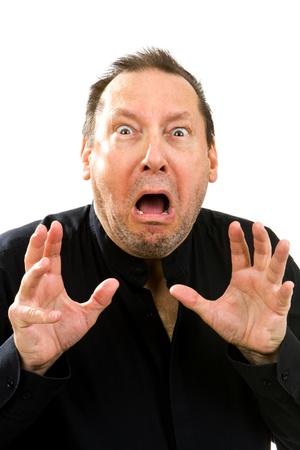 Angst: Schockiert und �ngstlich �lterer Mann h�lt seine H�nde in Angst.
