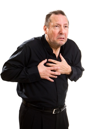 condition: Elderly man clutches his chest as he has a heart attack. Stock Photo