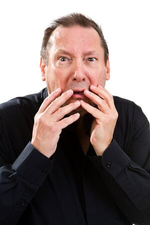 distressful: Elderly worrywart of a man holds his hands to his face as he is plagued by worry. Stock Photo
