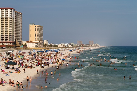 Pensacola Beach, FL – March 18: Tourists wade, swim and sunbath in the Gulf of Mexico during spring break weekend March 18, 2012 in Pensacola Beach, Florida. Stock Photo - 13154723