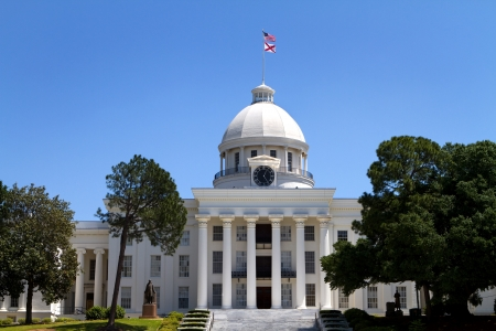 montgomery: Alabama State Capitol building and grounds in Montgomery, Alabama, USA against a blue sky
