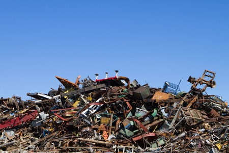 Scrap metal waste is stored in a recycling yard waiting to be melted down to manufacture new products