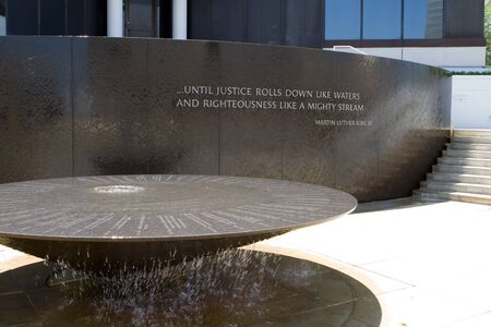 Montgomery, Alabama, USA - April 22, 2012: Water flows down from the table of the Civil Rights Memorial in Montgomery, Alabama, USA on April 22, 2012.  It is a monument to forty people who died in the struggle for equal rights. The memorial is a frequent
