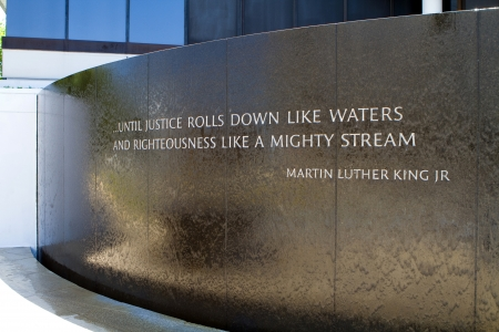 Montgomery, Alabama, USA - April 22, 2012: Water flows down the front of the Civil Rights Memorial in Montgomery, Alabama, USA on April 22, 2012.  It is a monument to forty people who died in the struggle equal rights. The memorial is a frequent starting
