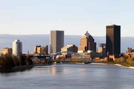 Rochester, New York, USA skyline viewed from the south at dusk with the Genesee River flowing toward the downtown area  Stock Photo