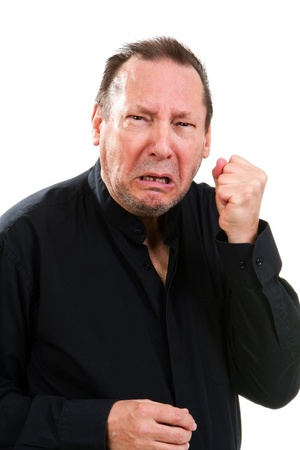 Combative elderly man clutches his fist with a agonized facial expression.